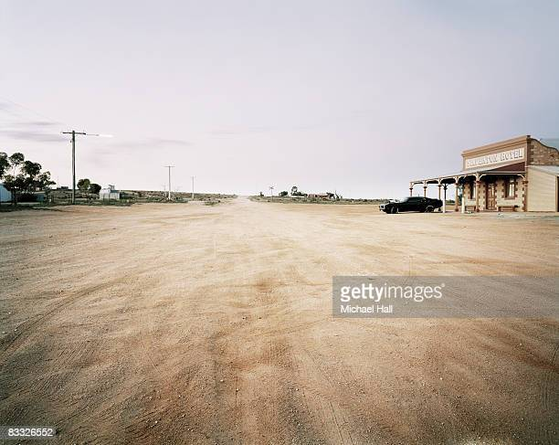 Deserted town with car and saloon