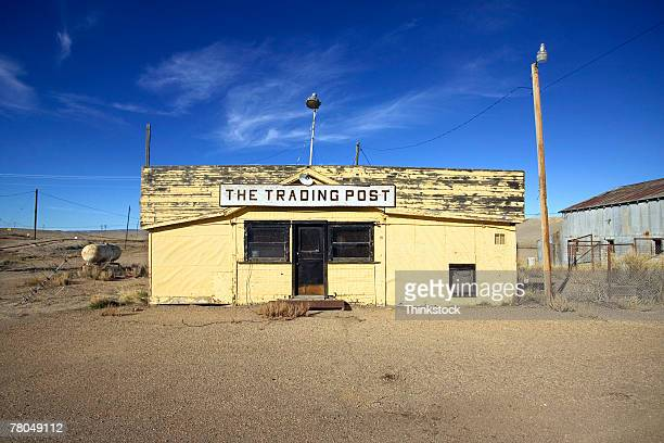 deserted trading post building and barn - trading_post stock pictures, royalty-free photos & images