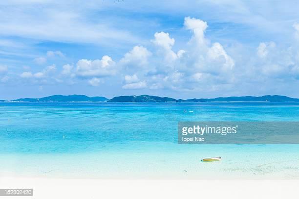 Deserted tropical beach and islands on horizon