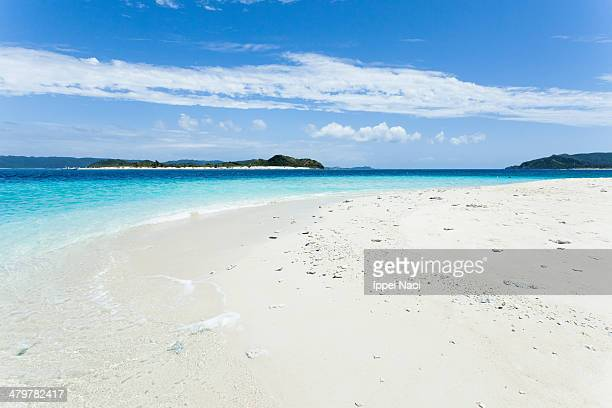 Deserted tropical beach, white sand and blue sea