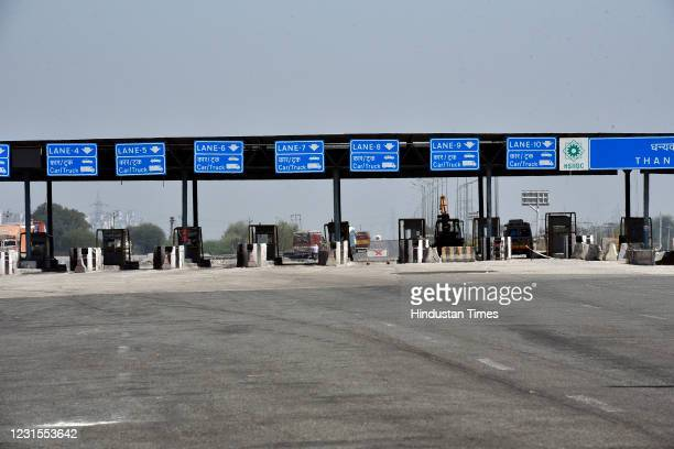 Deserted view of a toll plaza after farmers blocked the Western Peripheral Expressway to mark 100 days of their ongoing protests against the new farm...