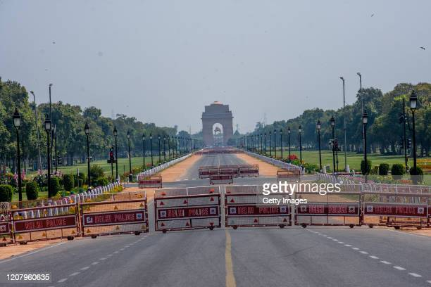 Deserted view of historic India Gate, during a one-day nationwide Janata curfew imposed as a preventive measure against the COVID-19 on March 22,...