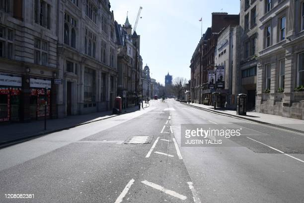 Deserted Whitehall is seen in central London on the morning on March 24, 2020 after Britain ordered a lockdown to slow the spread of the novel...
