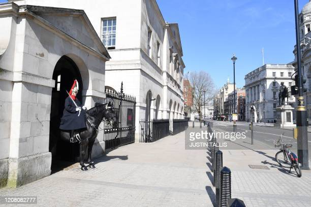 A deserted Whitehall is seen in central London on the morning on March 24 2020 after Britain ordered a lockdown to slow the spread of the novel...