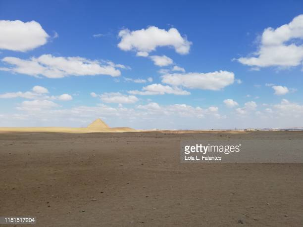 Desertic landscape with  the red pyramid of Dahshur at the background