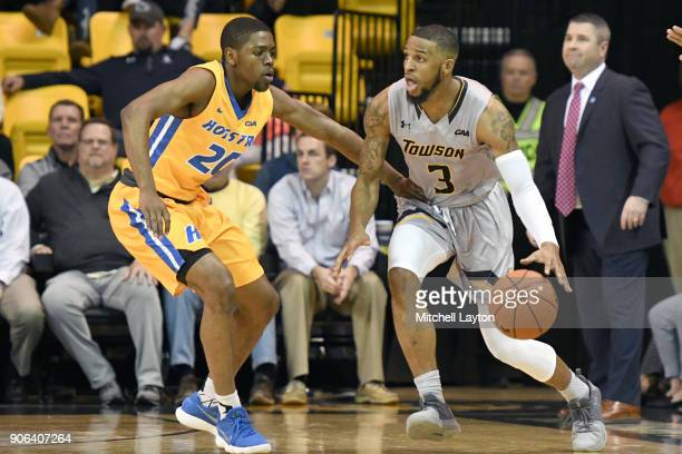 Deshaun Morman of the Towson Tigers dribbles around Jalen Ray of the Hofstra Pride during a college basketball game at SECU Arena on January 11 2018...