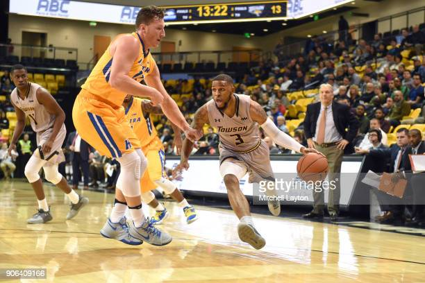 Deshaun Morman of the Towson Tigers dribbles around Rokas Gustys of the Hofstra Pride during a college basketball game at SECU Arena on January 11...