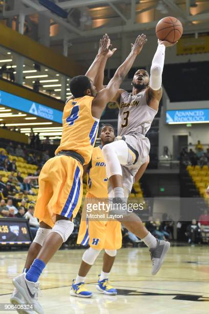 Deshaun Morman of the Towson Tigers takes a shot over Desure Buie of the Hofstra Pride during a college basketball game at SECU Arena on January 11...