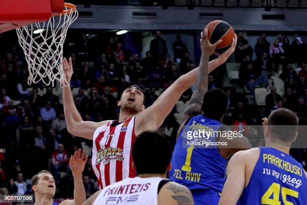 Deshaun Thomas #1 of Maccabi Fox Tel Aviv competes with Nikola Milutinov #11 of Olympiacos Piraeus during the 2017/2018 Turkish Airlines EuroLeague...
