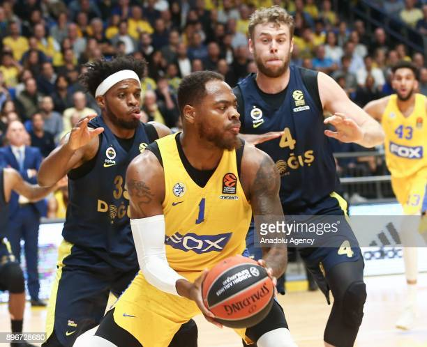 Deshaun Thomas of Maccabi Fox Tel Aviv in action against Bobby Dixon and Nicolo Melli during Turkish Airlines Euroleague match between Maccabi Fox...