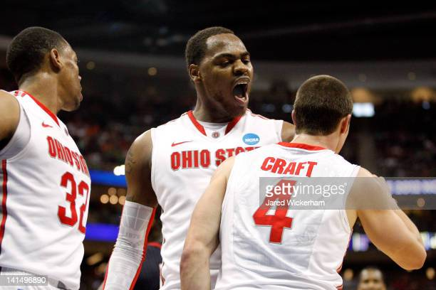 Deshaun Thomas of the Ohio State Buckeyes celebrates a play in the second half with teammates Aaron Craft and Lenzelle Smith Jr #32 against the...
