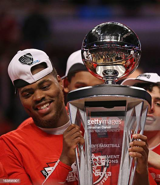 DeShaun Thomas of the Ohio State Buckeyes holds the trophy after the Buckeyes defeated the Wisconsin Badgers during the Big Ten Basketball Tournament...