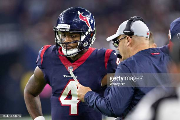 Deshaun Watson and Head Coach Bill O'Brien of the Houston Texans talk during a timeout during the second half of a game against the Dallas Cowboys at...