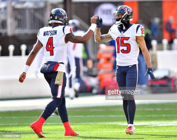 Deshaun Watson and Will Fuller V of the Houston Texans warm up prior to the game against the Cleveland Browns at FirstEnergy Stadium on November 15,...