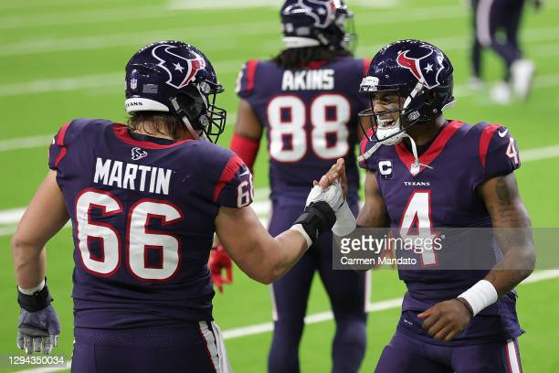 Deshaun Watson celebrates a touchdown with Nick Martin of the Houston Texans during the second half of a game at NRG Stadium on January 03, 2021 in...