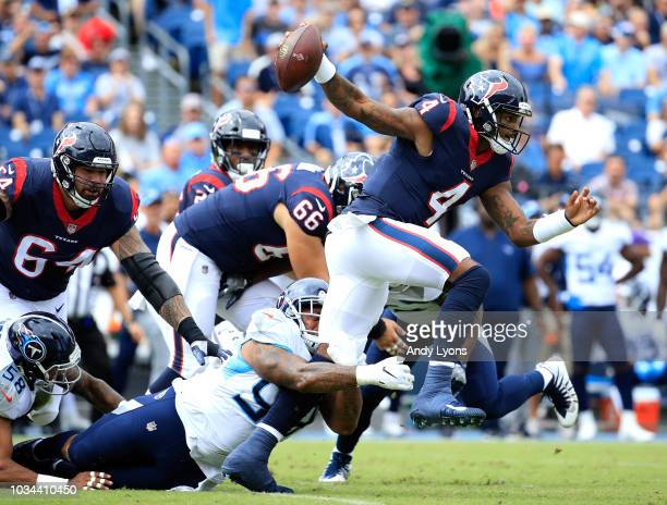 Deshaun Watson is tackled by Jurrell Casey during the Tennessee Titans vs Houston Texans at Nissan Stadium on September 16 2018 in Nashville Tennessee