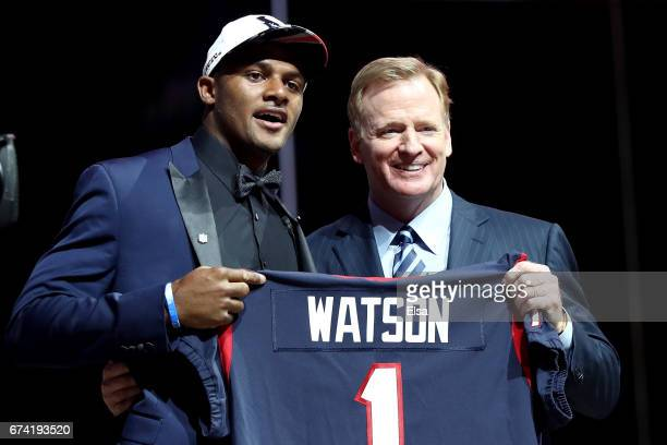 Deshaun Watson of Clemson poses with Commissioner of the National Football League Roger Goodell after being picked overall by the Houston Texans...