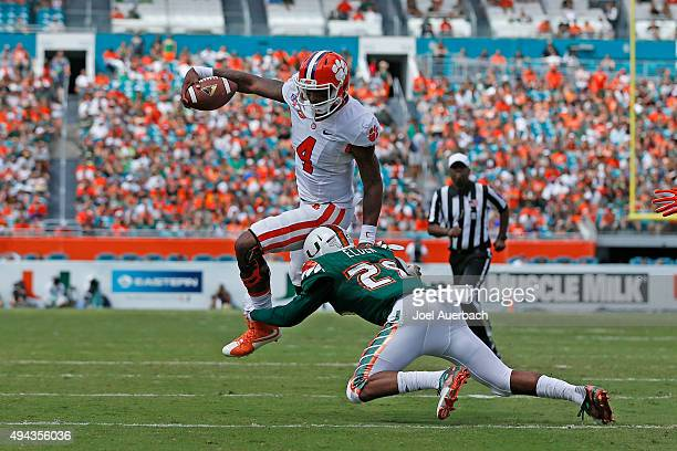 Deshaun Watson of the Clemson Tigers attempts to elude the tackle by Corn Elder of the Miami Hurricanes on October 24, 2015 at Sun Life Stadium in...