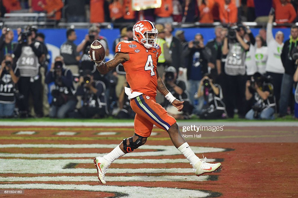 Deshaun Watson #4 of the Clemson Tigers celebrates after scoring a third quarter touchdown during the 2016 PlayStation Fiesta Bowl against the Ohio State Buckeyes at University of Phoenix Stadium on December 31, 2016 in Glendale, Arizona.