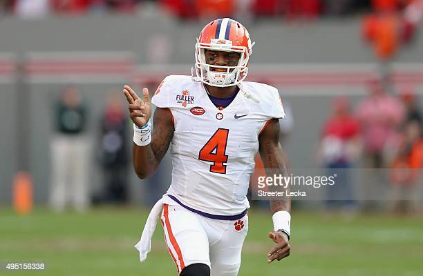 Deshaun Watson of the Clemson Tigers celebrates after throwing a touchdown during their game against the North Carolina State Wolfpack at...