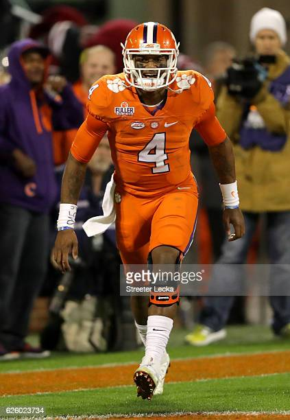Deshaun Watson of the Clemson Tigers celebrates after throwing a touchdown pass against the South Carolina Gamecocks during their game at Memorial...