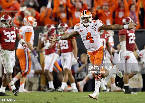 Deshaun Watson of the Clemson Tigers celebrates after throwing a 2-yard game-winning touchdown pass during the fourth quarter against the Alabama...