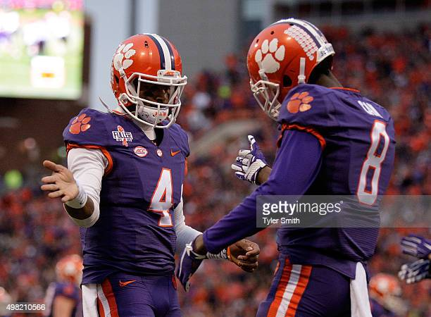 Deshaun Watson of the Clemson Tigers celebrates with Deon Cain after a touchdown during their game against the Wake Forest Demon Deacons at Memorial...
