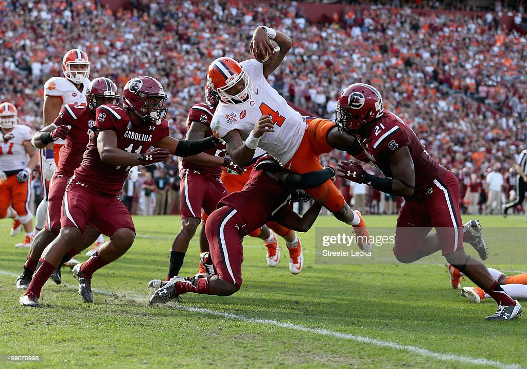 Deshaun Watson #4 of the Clemson Tigers dives for a touchdown during their game against the South Carolina Gamecocks at Williams-Brice Stadium on November 28, 2015 in Columbia, South Carolina.