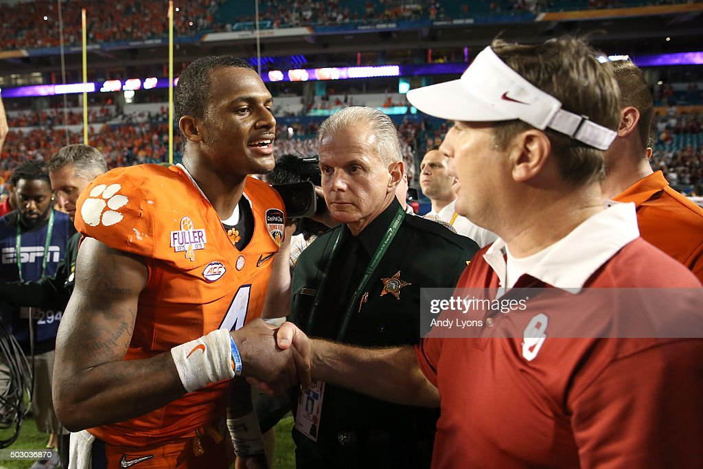 Deshaun Watson #4 of the Clemson Tigers greets head coach Bob Stoops of the Oklahoma Sooners after the Clemson Tigers defeat the Oklahoma Sooners with a score of 37 to 17 to win the 2015 Capital One Orange Bowl at Sun Life Stadium on December 31, 2015 in Miami Gardens, Florida.