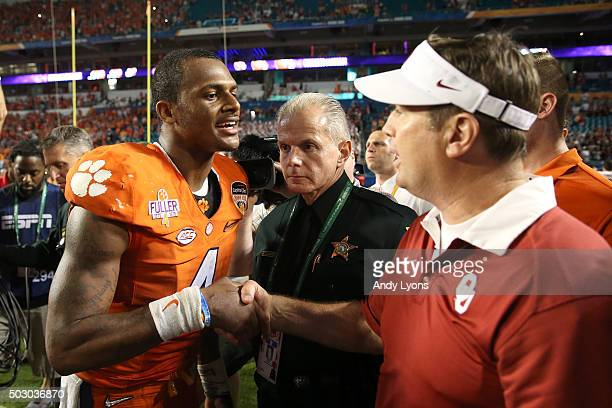 Deshaun Watson of the Clemson Tigers greets head coach Bob Stoops of the Oklahoma Sooners after the Clemson Tigers defeat the Oklahoma Sooners with a...
