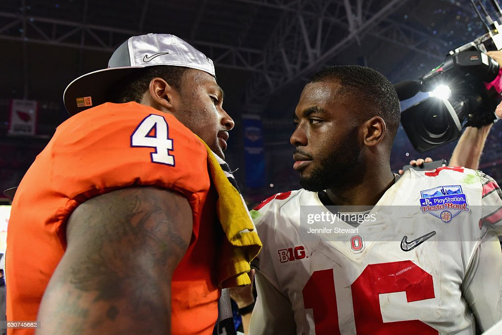 Deshaun Watson #4 of the Clemson Tigers greets J.T. Barrett #16 of the Ohio State Buckeyes after the Clemson Tigers beat the Ohio State Buckeyes 31-0 to win the 2016 PlayStation Fiesta Bowl at University of Phoenix Stadium on December 31, 2016 in Glendale, Arizona.