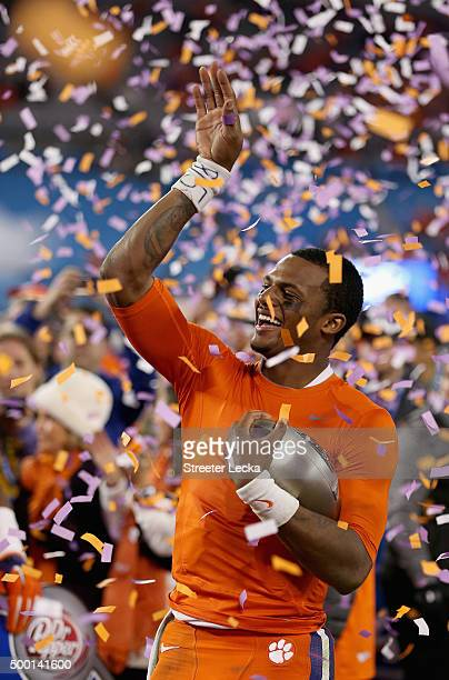 Deshaun Watson of the Clemson Tigers holds the ACC Championship trophy after defeating the North Carolina Tar Heels 4537 at the Atlantic Coast...