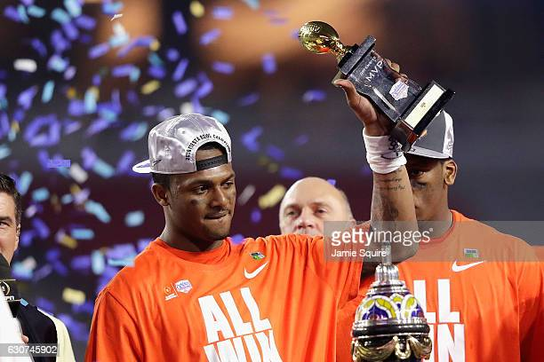 Deshaun Watson of the Clemson Tigers holds the Fiesta Bowl offensive MVP trophy after the Clemson Tigers beat the Ohio State Buckeyes 310 to win the...