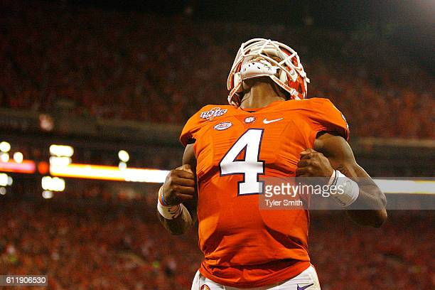 Deshaun Watson of the Clemson Tigers reacts after throwing a second quarter touchdown pass to Deon Cain not pictured against the Louisville Cardinals...