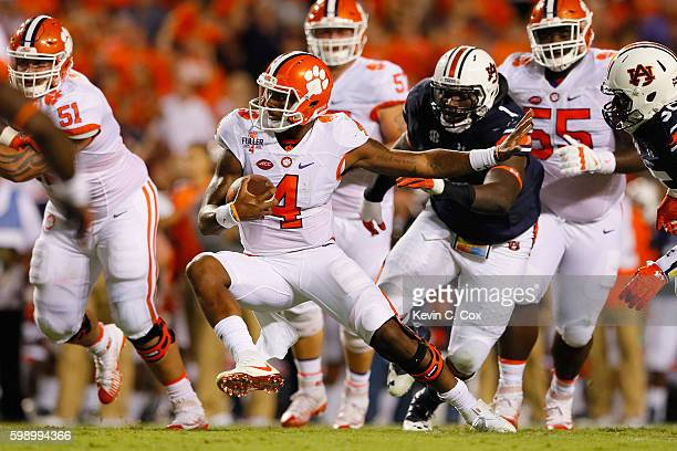 Deshaun Watson of the Clemson Tigers runs with the ball during the first half against the Auburn Tigers at Jordan Hare Stadium on September 3 2016 in...