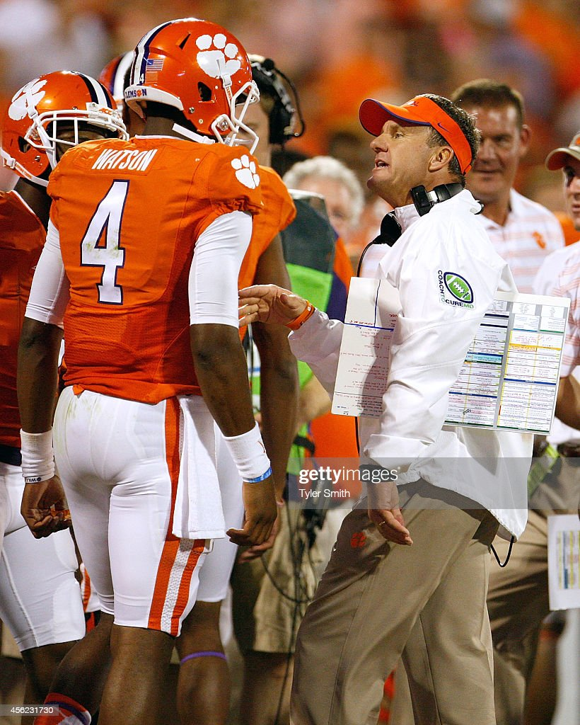 Deshaun Watson #4 of the Clemson Tigers talks with Offensive Coordinator Chad Morris during the game against the North Carolina Tar Heels at Memorial Stadium on September 27, 2014 in Clemson, South Carolina.