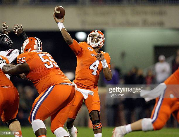 Deshaun Watson of the Clemson Tigers throws a pass for a touchdown during the game against the South Carolina Gamecocks at Memorial Stadium on...