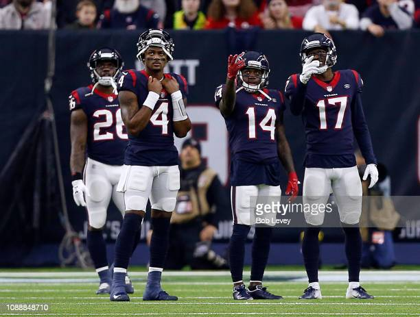 Deshaun Watson of the Houston Texans Alfred BlueDeAndre Carter and Vyncint Smith watch the video board during a play review against the Jacksonville...