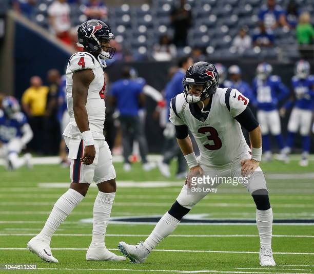 Deshaun Watson of the Houston Texans and Brandon Weeden warm up before playing the New York Giants at NRG Stadium on September 23 2018 in Houston...