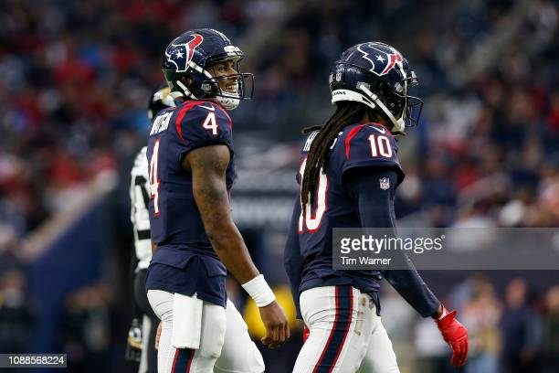 Deshaun Watson of the Houston Texans and DeAndre Hopkins walk to the sideline in the second half against the Jacksonville Jaguars at NRG Stadium on...