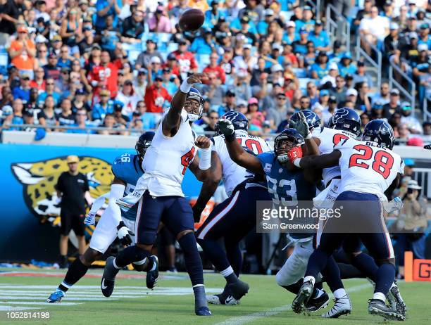 Deshaun Watson of the Houston Texans attempts a pass during the game against the Jacksonville Jaguars at TIAA Bank Field on October 21 2018 in...