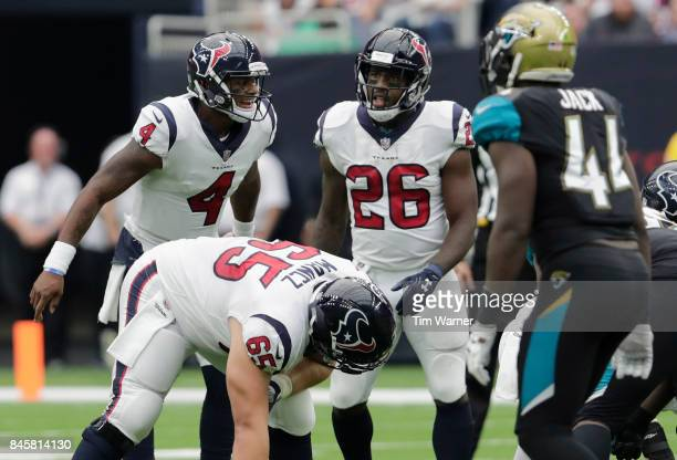 Deshaun Watson of the Houston Texans calls a play at the line of scrimmage in the third quarter against the Jacksonville Jaguars at NRG Stadium on...