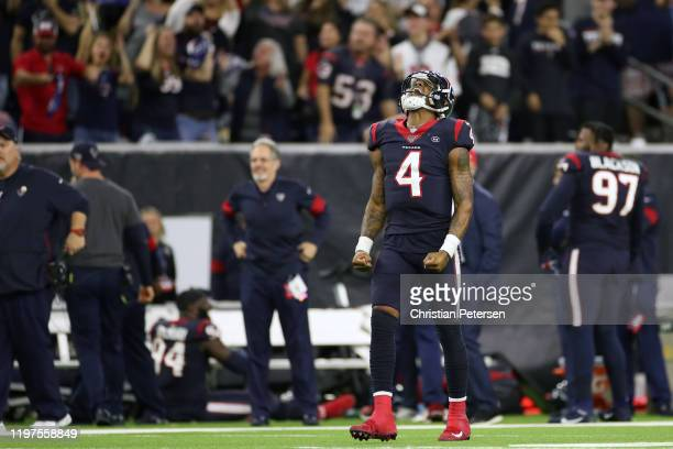 Deshaun Watson of the Houston Texans celebrates a 34yard pass completion to Taiwan Jones against the Buffalo Bills during overtime of the AFC Wild...
