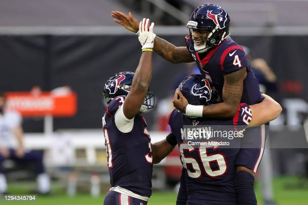 Deshaun Watson of the Houston Texans celebrates a touchdown during the second half of a game against the Tennessee Titans at NRG Stadium on January...