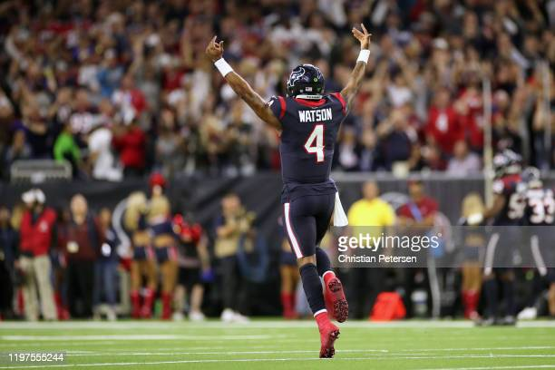 Deshaun Watson of the Houston Texans celebrates a touchdown pass and two point conversion against the Buffalo Bills during the fourth quarter of the...