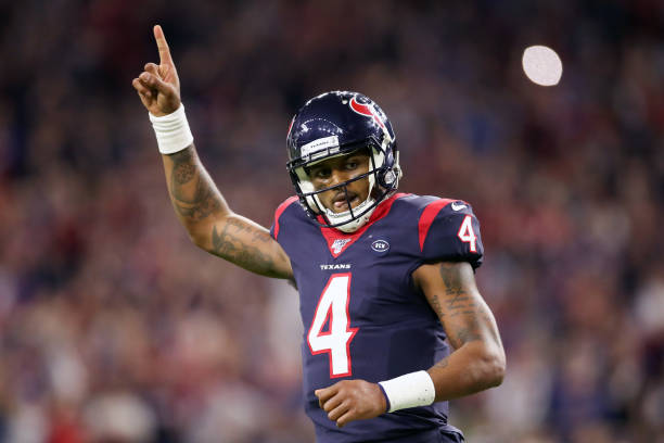 Deshaun Watson of the Houston Texans celebrates a touchdown pass against the Buffalo Bills during the fourth quarter of the AFC Wild Card Playoff...