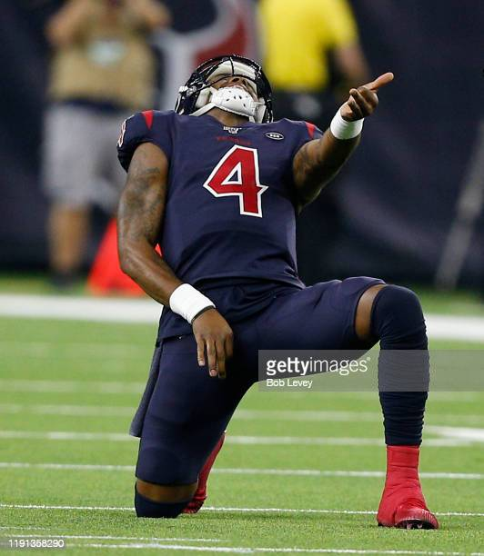Deshaun Watson of the Houston Texans celebrates after a touchdown pass to Kenny Stills during the third quarter against the New England Patriots at...