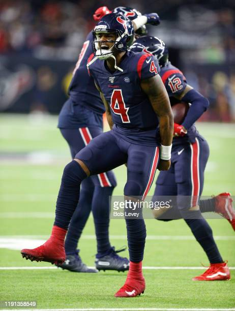Deshaun Watson of the Houston Texans celebrates after throwing a 35 yard touchdown pass to Kenny Stills during the third quarter New England Patriots...