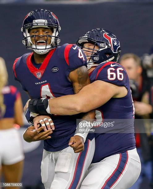 Deshaun Watson of the Houston Texans celebrates with Nick Martin after scoring a touchdown against the Jacksonville Jaguars at NRG Stadium on...