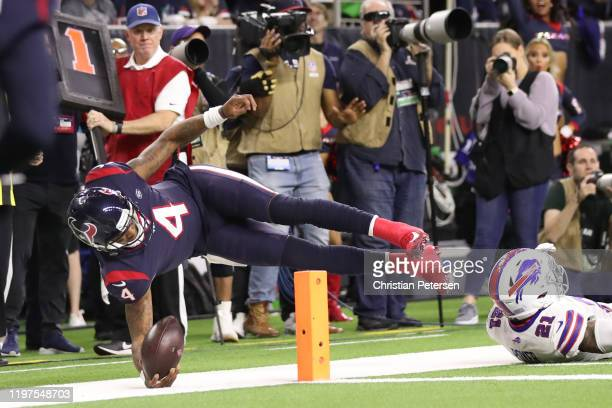 Deshaun Watson of the Houston Texans dives for a two point conversion against the Buffalo Bills during the third quarter of the AFC Wild Card Playoff...